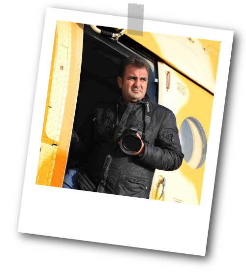 Alglid exiting a plane with his camera in his hand