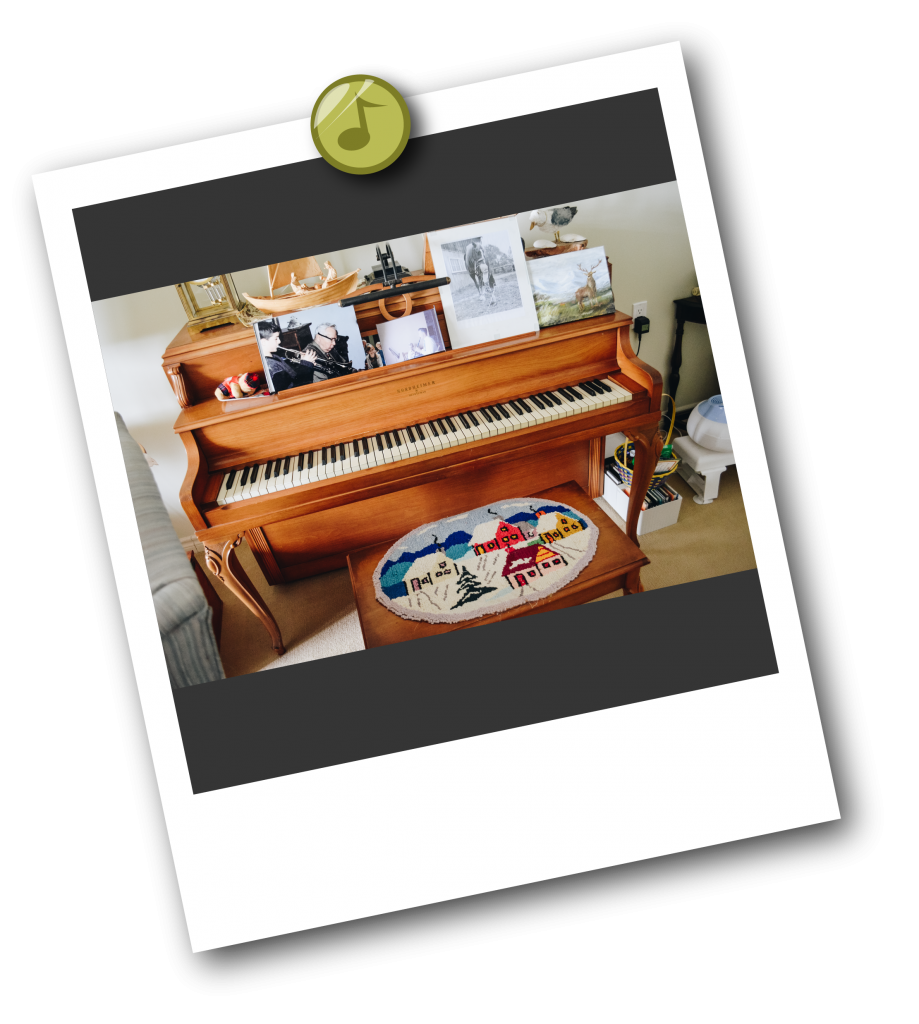 Audrey's upright piano covered in pictures, trinkets and memories.